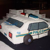 Police Car Grooms Cake A car cake for a groom who is a police officer. Cake is Chocolate with Chocolate Filling, chocolate buttercream crumb coat and MMF. Light...