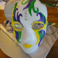 Mardi Gras Mask This was a red velvet cake with Raspberry cream cheese frosting cover in Ronda's MMF. The mask is gum paste and I drew on teh design...