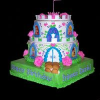 "Disney Princess Castle Cake  This is the Disney Castle Kit. ""Land"" is decendent chocolate with mocha french buttercream. Bottom of castle is butter cake with..."