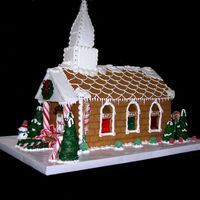 Gingerbread Church- Side View Here is another view of the gingerbread church. The stained glass windows are melted Jolly Ranchers.
