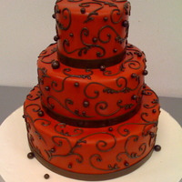 Red And Brown Scrolls red fondant icing with chocolate brown scrolls and balls