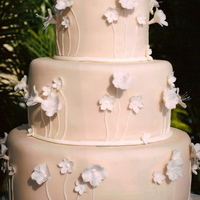 Ivory With White Blossoms Ivory fondant icing with white fondant flowers and hand piped stems