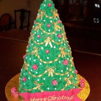 "Bunco (Dice) Christmas Tree 1 each 9"",8"",7"",6"",5"",4"" vanilla cake with strawberry filling topped with rice treats for the tip and covered..."