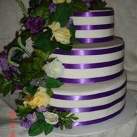 Triple Purple Stripe With Flowers Another version of the triple stripe cake dummy. Used a flower swag from Walmart and worked perfectly!