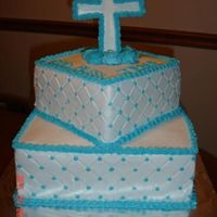 Boy 1St Communion Bottom layer white cake, top layer choclate cake, both chocolate buttercream filling. Diamond Impression with light blue dots and border....