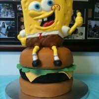Sponge Bob On A Crabby Patty  sponge bob is choclate candy melts (I used the wilton pan for the mold) and MMF for the pants and legs, and feet. I also attached with...