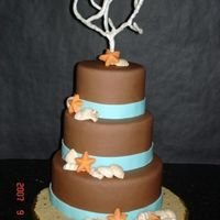 Beach Wedding The cake is covered with choc. fondant and the the coral is made out of floral wire covered with fondant.