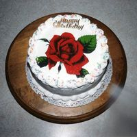 Rose Cake Needed a fast birthday cake, baked and decorated this round cake in no time at all. Thank you for looking.