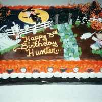 Hunter's Halloween B/day Cake This was a 1/2 sheet, 1/2 white and 1/2 chocolate with b/c icing. Hunter wanted a Halloween b/day cake. So I decorated what he wanted and...