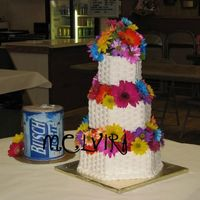 Flowers And Beer Basketweave on hexagon cake with fresh Gerbera daisies. Busch Light grooms cake created with edible images and fondant details.