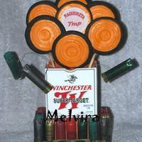 Trap Shooting Bouquet Sugar cookies airbrushed black with MMF details to look like clay pigeons. Bouquet assembled in an empty shell box, decorated with actual...