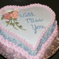 We'll Miss You Miss Baxter Chocolate cake iced w/BC. Flowers are royal icing.