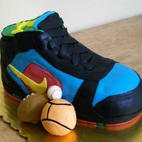 Little Nike This cake was for a little boy's first birthday and is a replica of one of his actual shoes. The second picture is of the original...