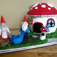 Gnomes At Home I made this for my mother's birthday. The mushroom house is a white cake with alternating layers of raspberry and bavarian cream...