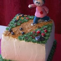 Autumncake With Lady Playing Boule A high chocolate and heavy cream cake with rasbeerrymousse filling.