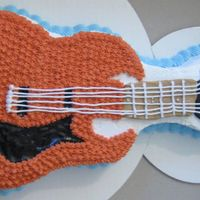 Another Guitar Cake Unfortunatly i was in a SUPER hurry with this cake because I had to plan an entire surprise party way off in the middle of nowhere, and try...