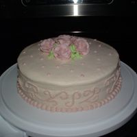 Final Class 1 Wilton 1 Cake   I had trouble with my filling bulging out of the sides of my cake, also had trouble getting my icing nice and flawless!!