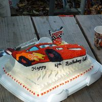 Cars Cake  This was a cake I made for a four year olds birthday ! He loved the cake... used the wilton cars pan. Bottom layer is butter cake with IMBC...