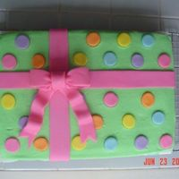 Another Gift Box   This is yellow cake w/extender added. All buttercream with MMF accents.