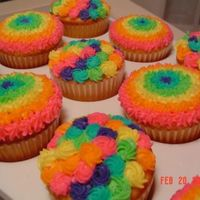 Rainbow Cupcakes These are yellow cupcakes with extender recipe added and all buttercream. They are for my 2 year old's two teachers' birthdays.