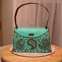 Purse Cake #2 This is DH Devil's Food with the Extender recipe added plus 1/4 cup of Dutch Processed Cocoa. All buttercream frosting with a ribbon...