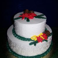 Bc Christmas Buttercream cake, BC swirls and dots, BC poinsettias, leaves and ribbon. It was very hot and my BC was not cooperating, so flowers are a...