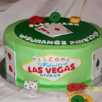 Las Vegas   Grooms cake. BC with fondant accents.