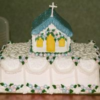 Pastor Heading To Mission Field Cake   Farewell Cake to our dearly loved Pastor, called to the Mission Field. Church is a decorated gingerbread house (with royal icing).