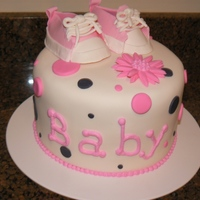 Baby Shoes Baby Shower Cake Copied a cake that was on here. It was the cutiest cake ever!!! Mine turned out ok but the original one was adorable! Whoever did that cake...