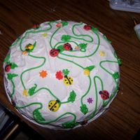 100_0546.jpg   this is a butter cake with vanilla icing and royal icing flowers and bugs