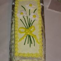 Daffodils My first attemp at royal icing flowers. The cake is a 9x13 cut into thirds and stacked.