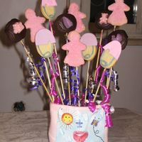 Baby Bouquet A mix of cookies that I arranged in a bouquet and brought extras on a platter to my SIL when she gave birth. Diaper pins are NFSC with MMF...