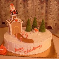 Santa Left His Bag Lemon cake with buttercream icing. House and pathway are made with gumpaste and royal icing, trees are sugar cones with royal icing, Santa...