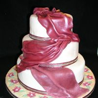 Maroon And Ivory Draped Cake 3 tier maroon and Ivory fondant cake with fondant covered mosaic board.