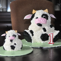 Cow Cake  this was for my son's first birthday!i used the stand up bear pan and cut the ears so they formed horns and then made ears out of...