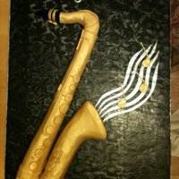 Saxaphone This was a tenor sax. Had to do another small cake to go along with it, not enough cake! It was actually a life size replica on a huge...