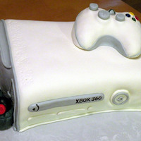 Gamers Delight! This is an XBox cake made with vanilla cake and vanilla buttercream. Covered and decorated in MMF. This is probably my favorite cake so far...