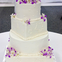 Hawaiian Themed Wedding Cake  WASC with different fillings, lemon cream, raspberry cream and chocolate, decorated with buttercream. The couple was married in Hawaii and...