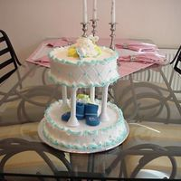 Baby Shower Cake   All buttercream and real booties and pacifiers on top.