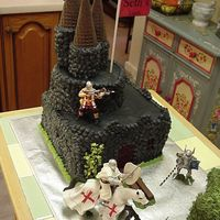 Castle Cake Castle cake for my neighbors son. Had so much fun making it! Just kept trying to add on. It is all buttercream with plastic figurines. The...