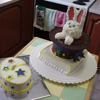 Magic Top Hat This cake was a challenge. Had tons of trouble with the ears.( too much frosting) and keeping it secure. The brim and the hat is made from...