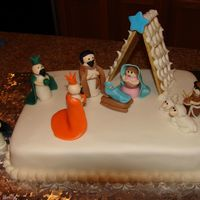 Nativity Scene Used 9 X 13 cake, all the figures are hand sculpted the barn is made of graham crackers