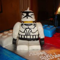 Lego And Starwars Clone Trooper   clone trooper was made of rice crispies covered in fondant, legos are the cake used 9X13 pans and cut them in threes.