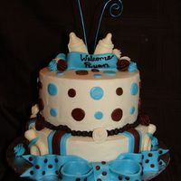 Blue, Brown And Polka Dot Boy Baby Shower Cake The cake is covered in buttercream and the decorations are made of Marshmallow fondant and some candy melts for the bottle and pacifier.