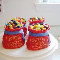Bertie Botts Beans   Mini-wondermold cakes covered in fondant & topped with jelly beans. I got the idea from an old Wilton Yearbook.