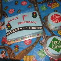Marcos And Tristan First Birthday Cake  Two friends sharing a first birthday party. Buttercream icing with fondant accents. Tried to make it to compliment the tablecloth. Two...