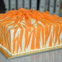 Stripes Cake   Moist Vanilla cake with Butter icing, fondant accents. Thank you for looking.