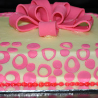 Pink Bow Cake Moist Marbled cake with Butter icing & fondant accents. Thank you for looking.