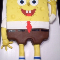 Spongebob Square Pants Spongebob cake, covered in fondant. Legs and arms made from rice treats covered with fondant.
