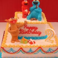 Sesame Street - Elmo, Cookie Monster And Zoey Figures were made from gumpaste (started with rice crispy treats the covered). This was my first attempt at figures....wasn't real...